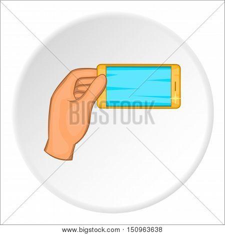 Hand holding smartphone icon. Cartoon illustration of hand holding smartphone vector icon for web