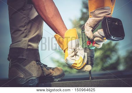 Small Residential Remodeling Works Closeup Photo. Construction Worker with Driller in Hands.