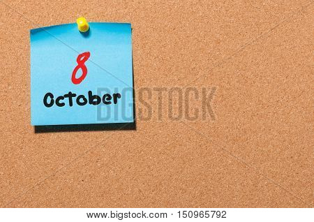 October 8th. Day 8 of month, color sticker calendar on notice board. Autumn time. Empty space for text.