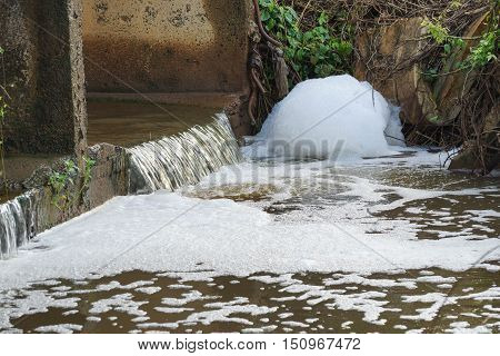 Water pollution - Waste water full of bubbles released from the industrial ares affecting natural water resources