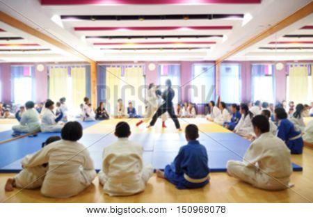 Blurred background of taekwondo training in gymnesium