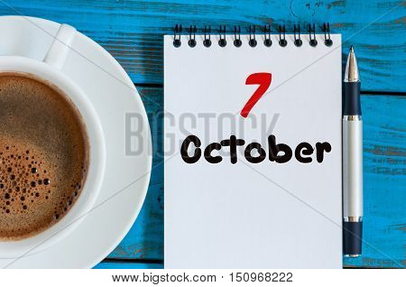 October 7th. Day 7 of month, Morning coffee cup with calendar on chief workplace background. Autumn time. Empty space for text.