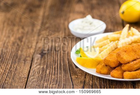 Fisch Sticks (close-up Shot) On An Old Wooden Table