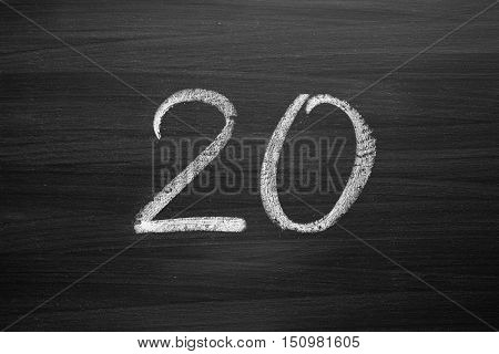 number twenty enumeration written with a chalk on the blackboard