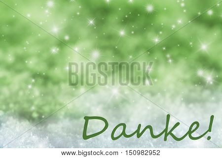 German Text Danke Means Thank You. Green Sparkling Christmas Background Or Texture With Snow. Copy Space For Your Text Here
