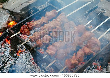 Cooking Pork Shashlik On Skewer, In Brazier Outdoors