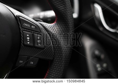 Control buttons on steering wheel in a modern car.