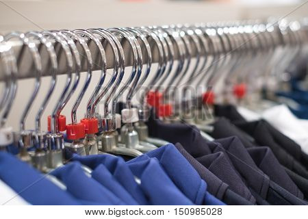 Cloth store, Close up cloths rack with hanger in row.