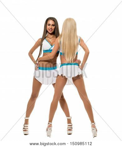 Cheerleading. Tall pretty girls posing in studio, isolated on white