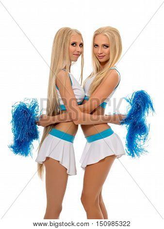 Studio photo of sexy cheerleaders hugging at camera
