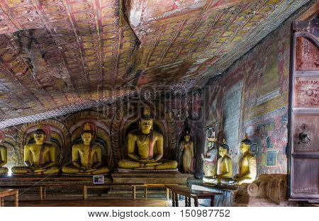Cave in Dambulla, Sri Lanka. Cave temple has five caves under a vast overhanging rock and dates back to the first century BC