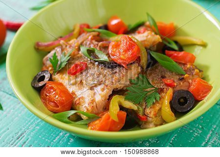 Fried Hake Fillet With Tomato And Olives In The Mediterranean Style