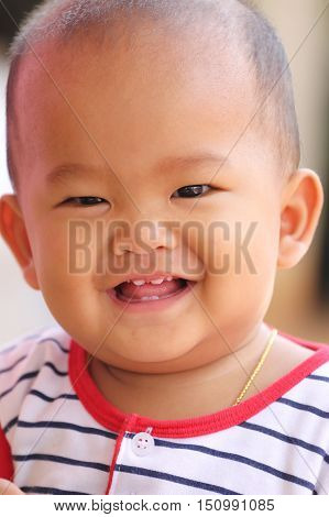 Asian baby of toddler and have teething in smile with happilyconcept of health and development of the children.