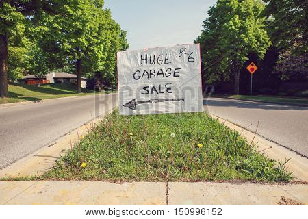 Yard Sale sign in the middle of a street