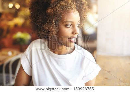 Profile Shot Of Cute Young Dark-skinned Student Girl Dressed In Stylish Top Spending Free Time At Un