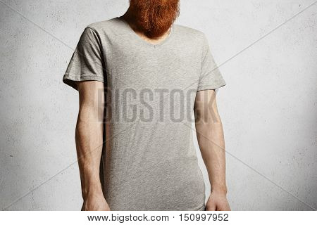Trendy Redhead Student Wearing Blank Copy Space T-shirt Spending Free Time Indoors. Caucasian Model