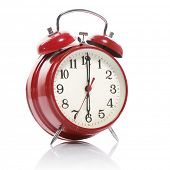 red old style alarm clock isolated on white poster