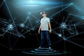 3d technology, virtual reality, entertainment, cyberspace and people concept - happy young man with virtual reality headset or 3d glasses and projection over dark background poster