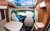 Man driving on a road in the Camper Van. Caravan car Vacation. Family vacation travel, holiday trip in motorhome poster