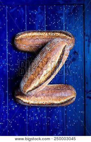 Durum Sesame Sourdough Bread On A Blue Table Board