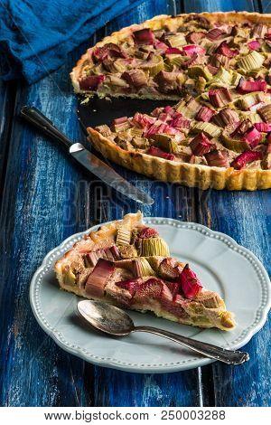 Slice Of Rhubarb Tart Served On A Grey Plate