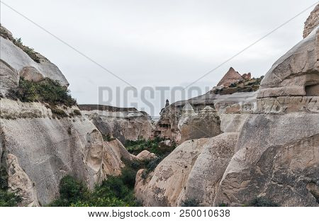 majestic view at bizarre rock formations in cappadocia, turkey poster