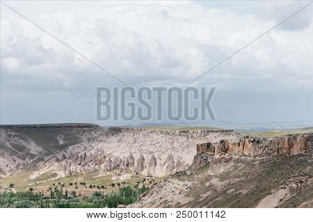 majestic landscape with bizarre rock formations in goreme national park, cappadocia, turkey poster