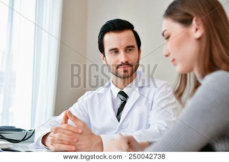 Health Concepts. The Doctor Is Examining The Patient's Health. Patients Are Happy To Come To The Doc