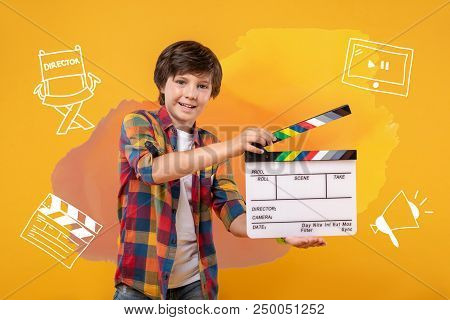 Film Director. Positive Emotional Boy Feeling Excited And Smiling While Imagining His Career Of A Fi