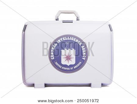 Used Plastic Suitcase With Stains And Scratches, Printed With Flag - Cia