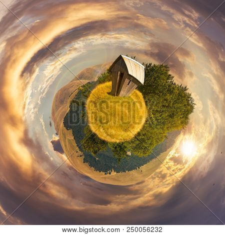 Woodshed On Little Planet Spherical Panorama At Sunset. Beautiful Countryside Concept With 360 Degre