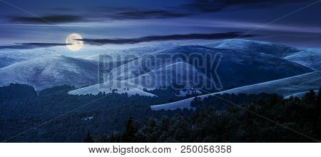 Beautiful Mountainous Background At Night In Full Moon Light. Lovely Summer Scene With Rolling Hills