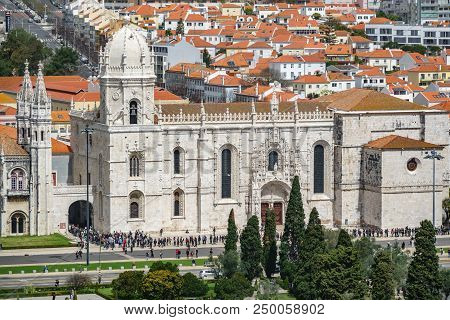 Long Shot Of Hieronymites Monastery Entrance With Tourists In A Row, Lisbon