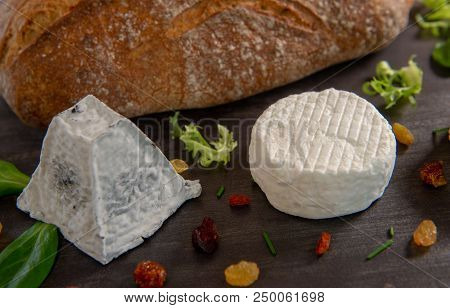 French Goats Cheeses And Bread On Background