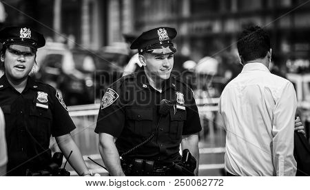 New York, Usa - Sep 21, 2017: Police Officers Performing His Duties On The Streets Of Manhattan. New