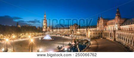 Night view of Spain Square on sunset, landmark in Renaissance Revival style, Seville, Andalusia, Spain. poster