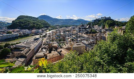 Beautiful Panoramic Summer View Of Salzburg City With Festung Hohensalzburg Castle And Salzach River