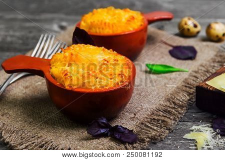 Two Ceramic Cocotte Frying Pan Pan With Baked In The Oven Pasta Macaroni With Cheese. Ingredients Fo