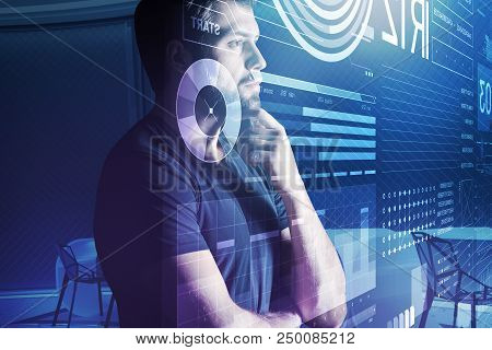 Serious Programmer. Calm Experienced Programmer Thoughtfully Touching His Chin While Looking Attenti