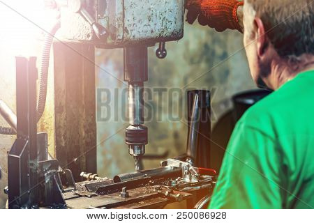 Turner Works On A Lathe. Factory, Production, Metal Processing. Shallow Depth Of Field, Blur In Moti