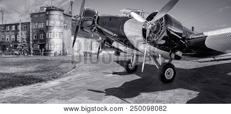 Historical Aircraft On An Airport In Black And White