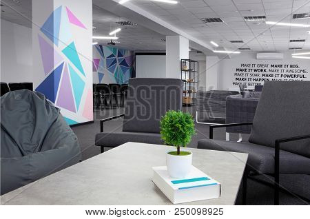 Conference Hall.coffe Table With Green Plant And Armchair On The First Plan .office. With Motivation