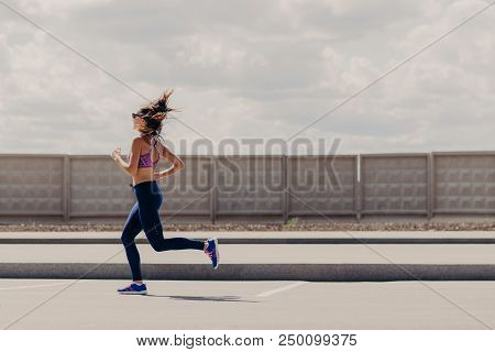 Stylish Female Jogger Dressed In Sportswear, Enjoys Sport Activities, Has Outdoor Exercises, Likes R