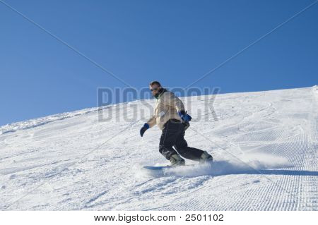 Snowboarding In The Mountain Stock Photo