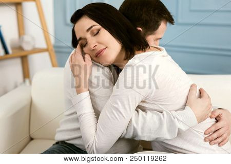 My Husband. Attractive Nice Pleasant Woman Hugging Her Husband And Enjoying The Moment While Express