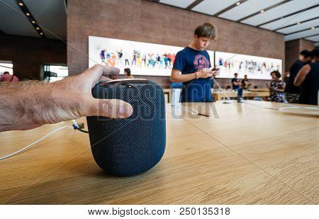 Paris, France - Jul 16, 2018: Man Admiring New Apple Store The Latest Apple Computers Homepod Smart