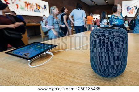Paris, France - Jul 16, 2018: People In Apple Store And The Latest Apple Computers Homepod Smart Spe