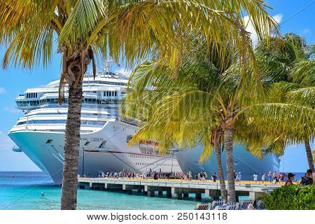 Grand Turk, Turks And Caicos Islands - April 03 2014: Carnival Cruise Ships Docked Side By Side At T