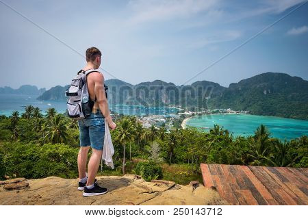 Young Tourist Enjoys Panoramic View Over The Tonsai Village And The Mountains Of Koh Phi Phi Island