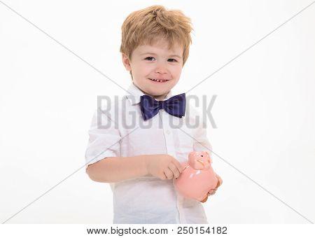 Little Smiling Boy Holds Piggy Bank. Boy Holding Moneybox. Saving Money Concept. Piggy Bank. Finance